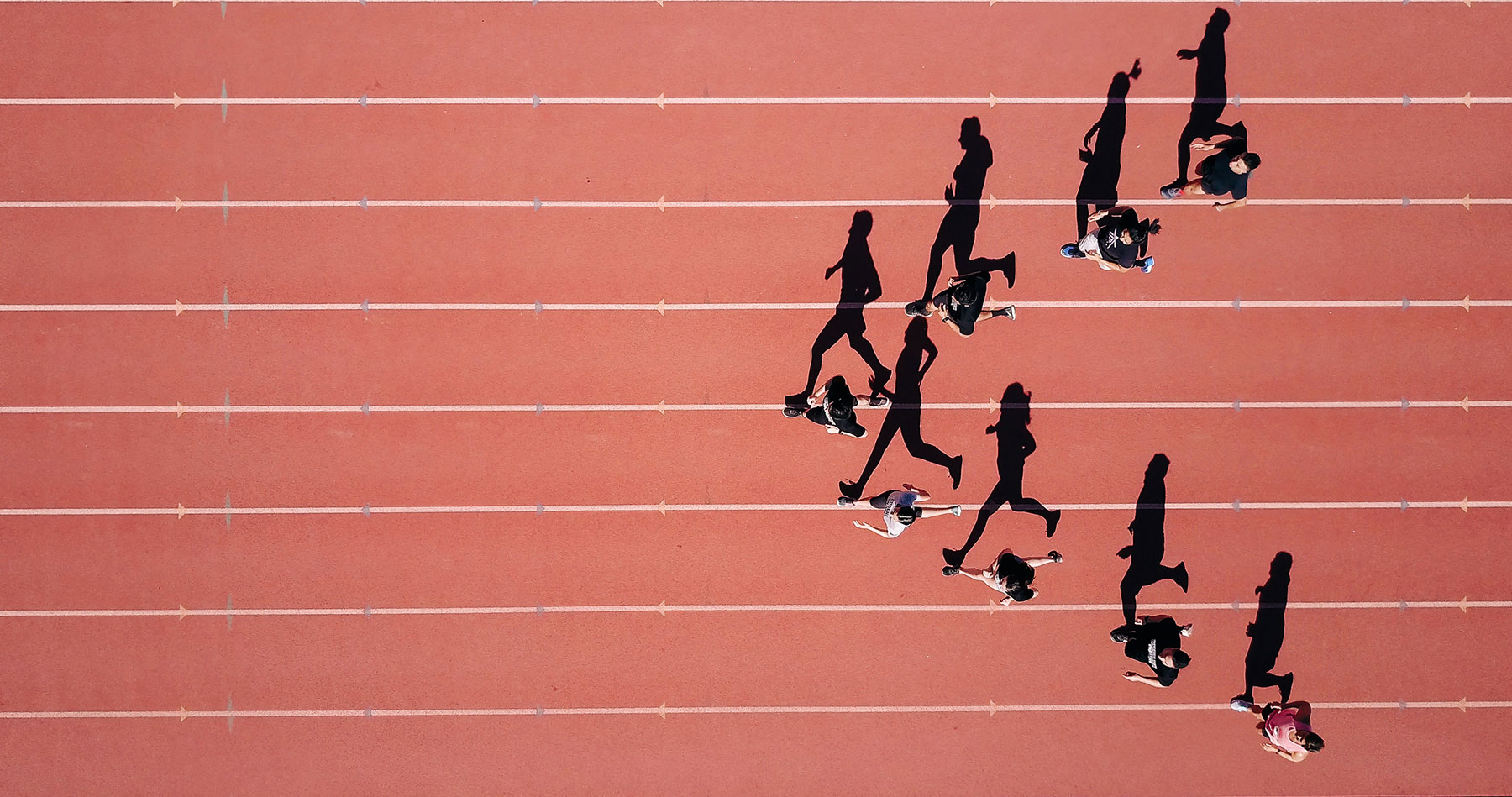 Runners on a running track